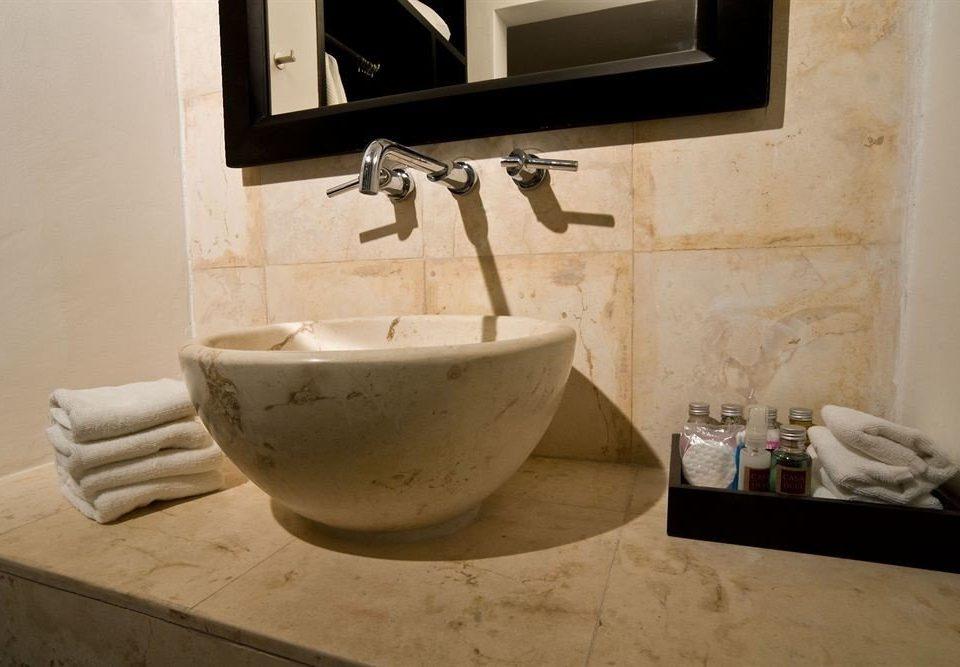 bathroom plumbing fixture sink ceramic bidet flooring home bathtub tile toilet countertop dirty