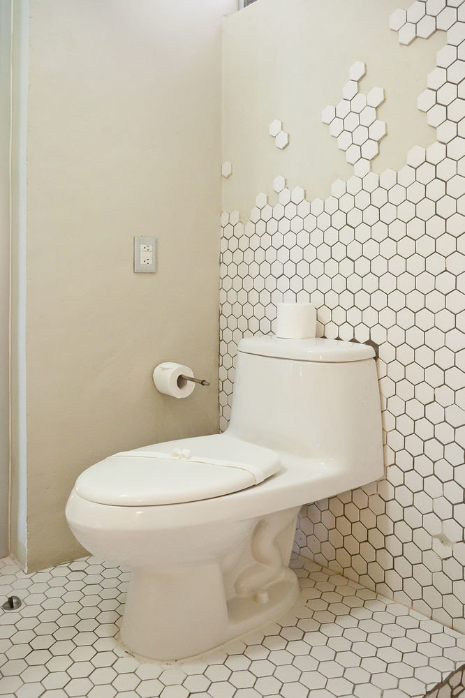 bathroom toilet plumbing fixture bidet bathtub flooring ceramic tile rack tiled