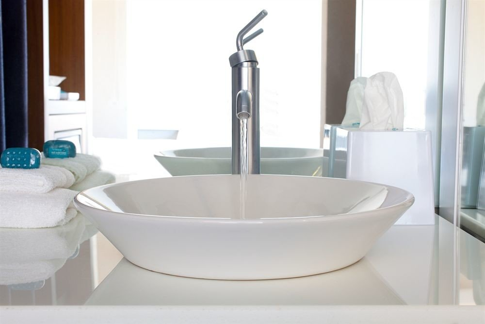 bathtub bathroom sink plumbing fixture bidet tap swimming pool ceramic flooring tub water basin