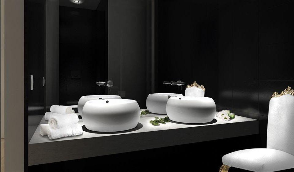 mirror white bathroom sink bathtub bidet lighting plumbing fixture flooring ceramic public