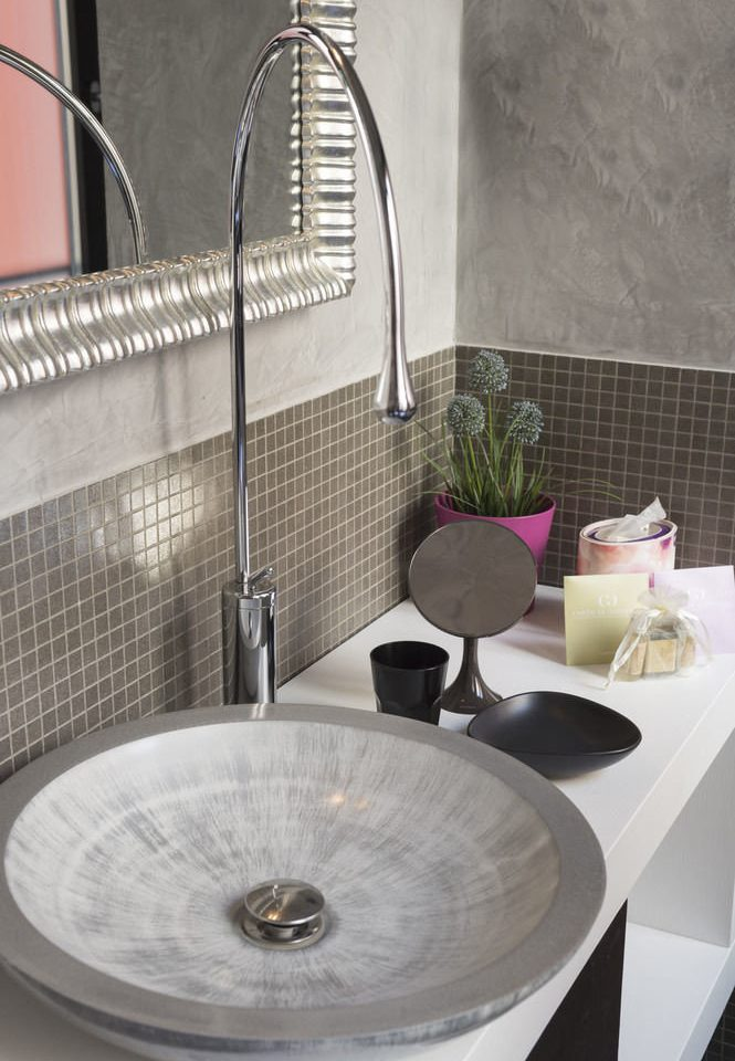 sink plumbing fixture bathroom countertop bidet tap bathtub ceramic tiled