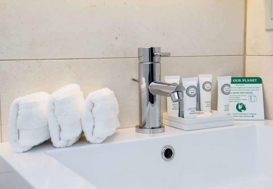 bathroom plumbing fixture toilet bathtub bidet sink product tap counter flooring ceramic public toilet kitchen appliance