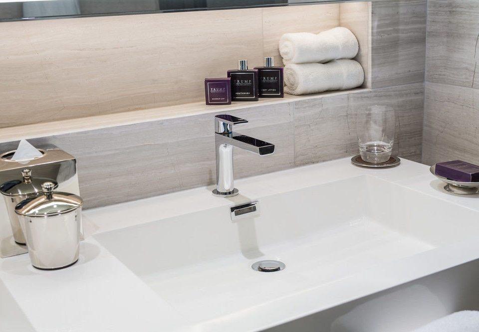 bathroom sink plumbing fixture bidet countertop bathtub flooring tile ceramic tap water basin