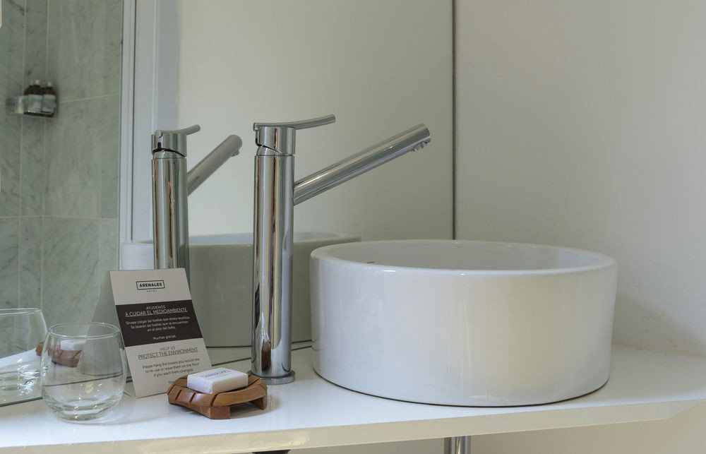 toilet plumbing fixture bathroom bathtub bidet lighting sink ceramic