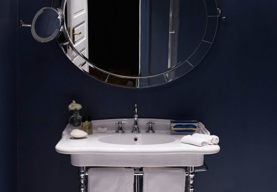 bathroom sink mirror plumbing fixture bidet toilet bathtub circle tap tile
