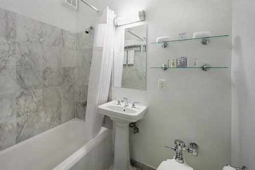 bathroom property plumbing fixture sink toilet white bidet bathtub vessel cottage