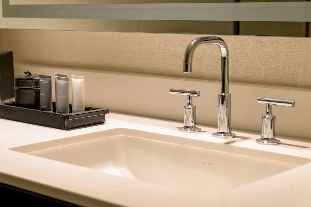bathroom sink mirror countertop counter plumbing fixture toilet vessel water basin bathtub bidet tap flooring tile