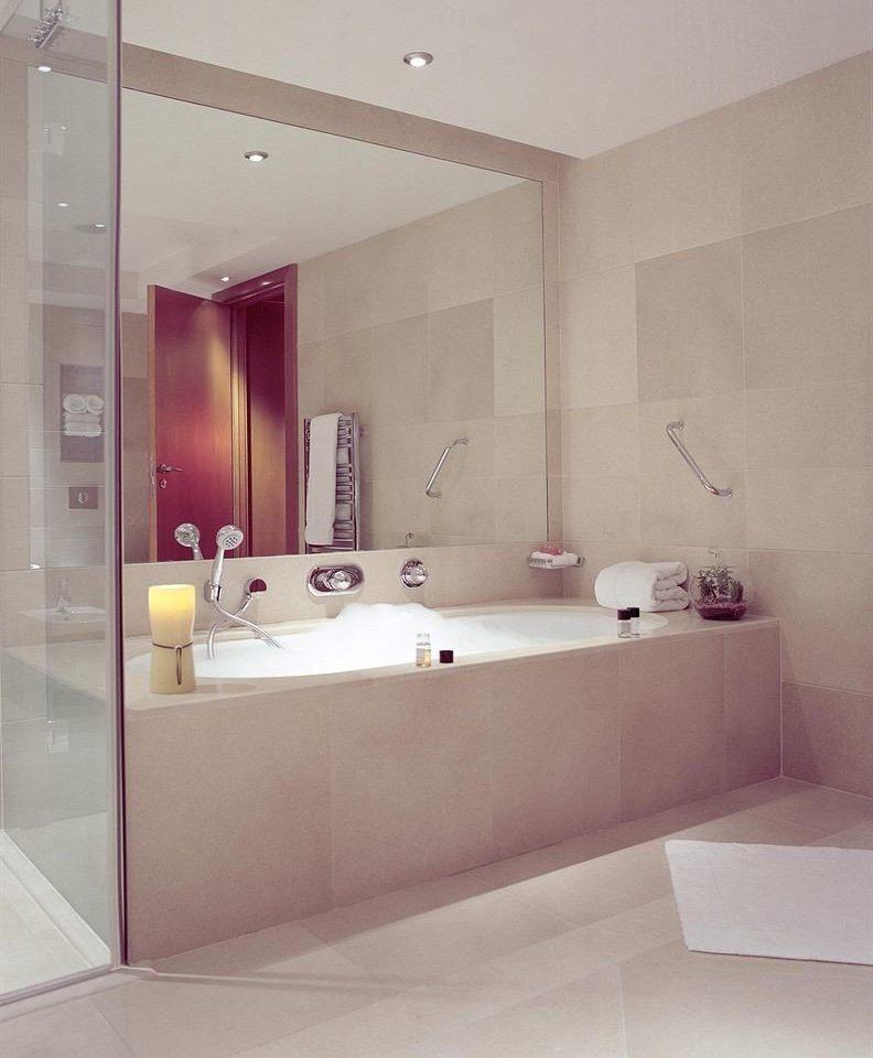 bathroom property bathtub sink plumbing fixture white bidet flooring counter