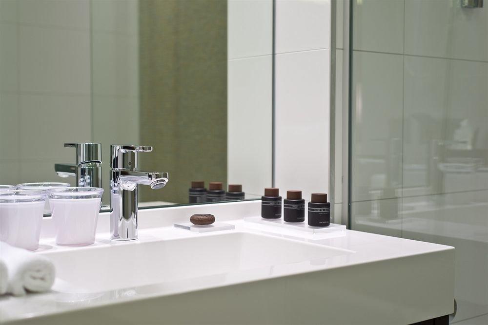 bathroom sink countertop toilet counter plumbing fixture bathtub tile glass bidet flooring tap material water basin