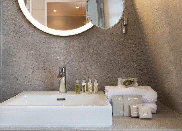 toilet bathroom property sink bathtub plumbing fixture flooring tile home bidet counter
