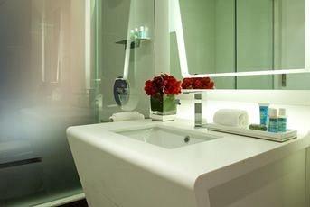 bathroom mirror sink bathtub countertop plumbing fixture bidet toilet