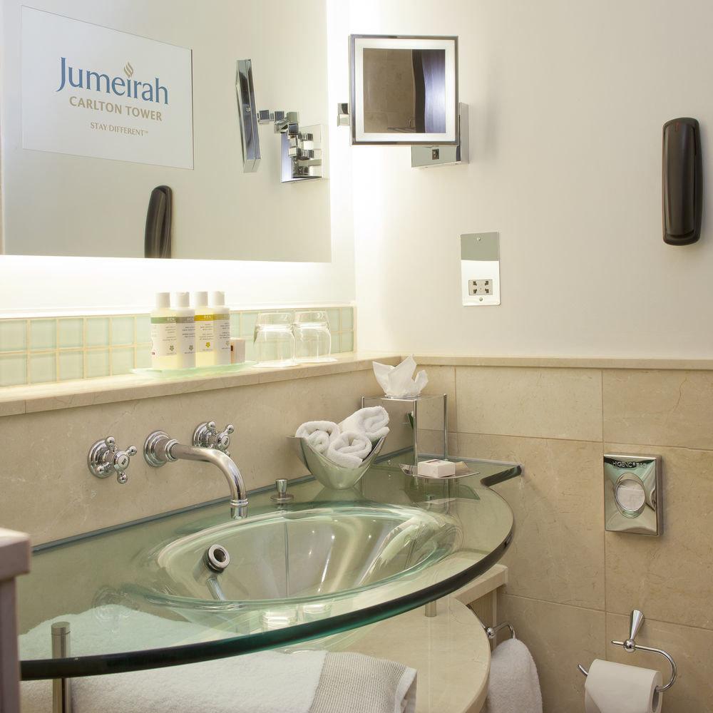 bathroom sink mirror property vessel home countertop plumbing fixture bathtub flooring tile toilet bidet water basin