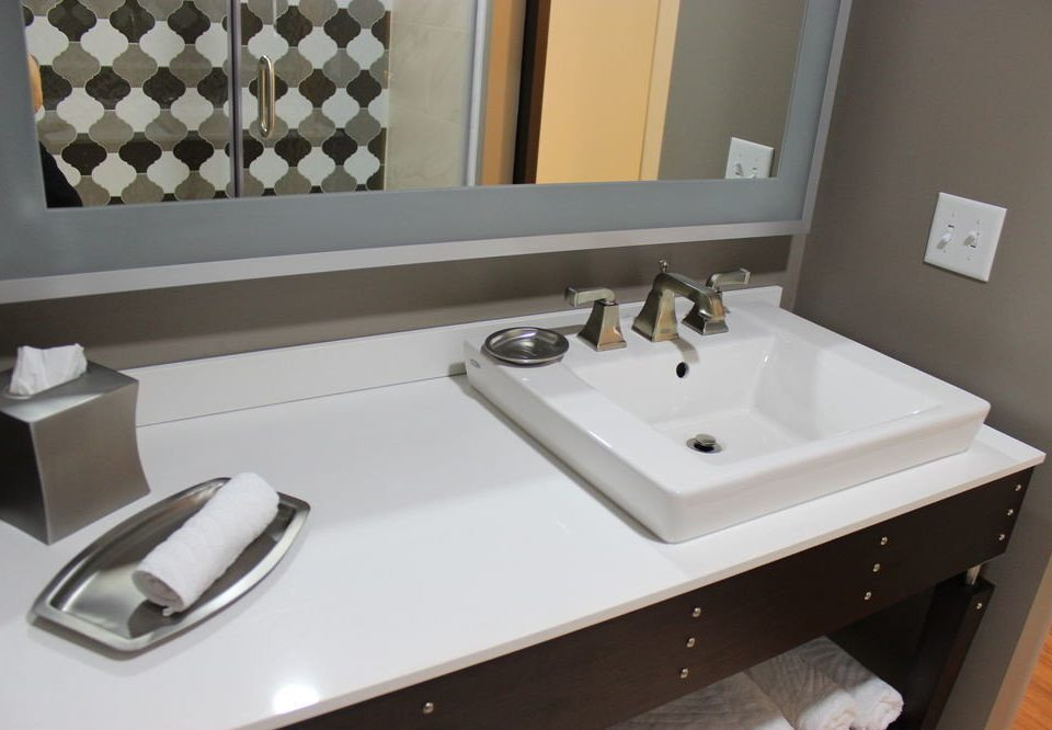 bathroom sink mirror property plumbing fixture countertop bidet bathtub flooring