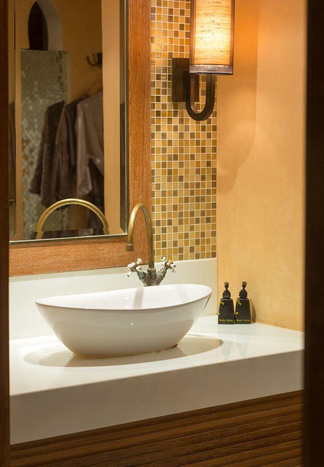 bathroom sink mirror bathtub plumbing fixture bidet flooring countertop