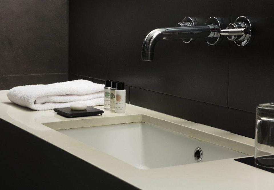 sink plumbing fixture bathtub countertop bathroom bidet tap flooring