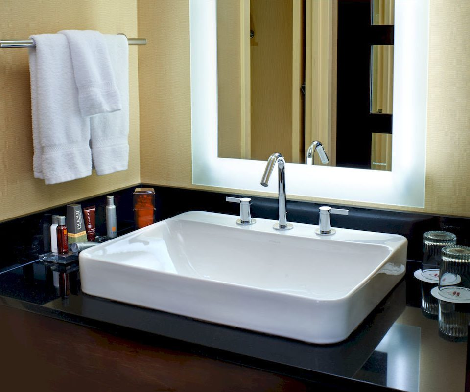 bathroom sink mirror bathtub plumbing fixture home countertop bidet swimming pool towel flooring rack