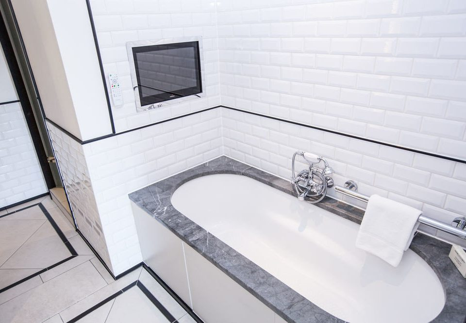 bathroom property sink white bathtub swimming pool flooring tile plumbing fixture bidet toilet tiled