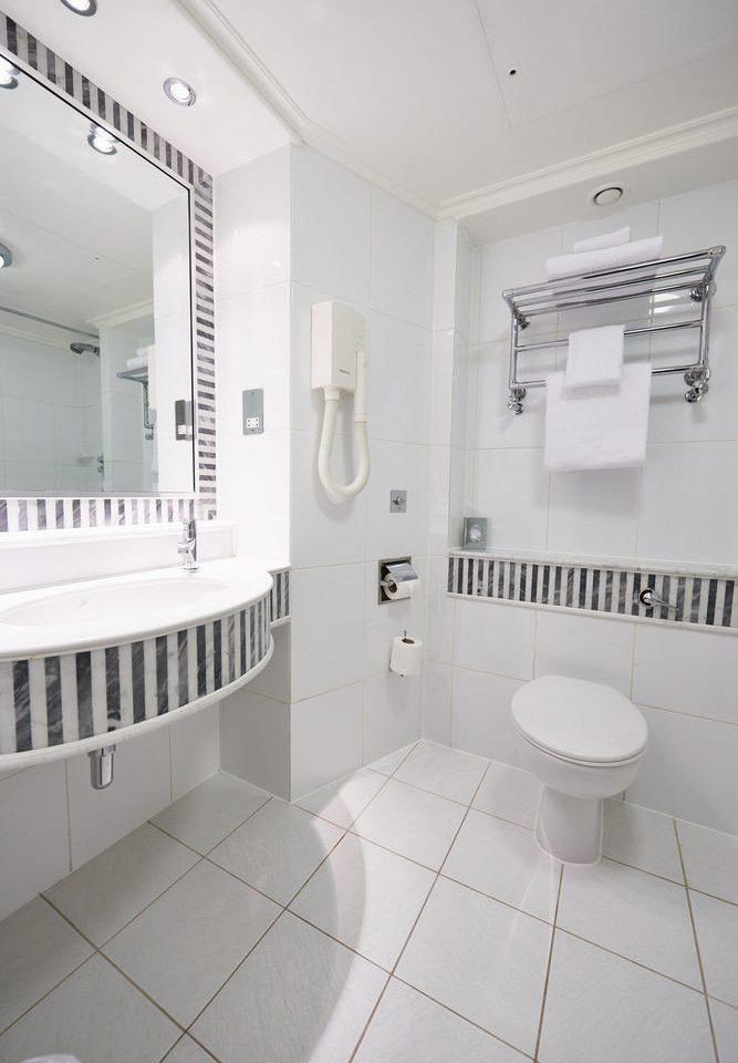 bathroom property white flooring bidet tile toilet bathtub tiled