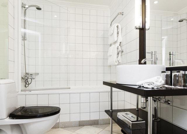 bathroom property plumbing fixture bathtub tile bidet flooring sink toilet tiled