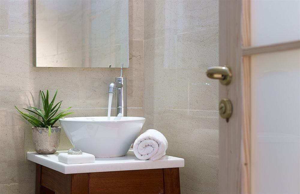 bathroom property plumbing fixture bathtub home bidet sink flooring tile