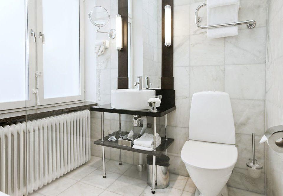 bathroom property plumbing fixture bidet toilet flooring tile public toilet bathtub