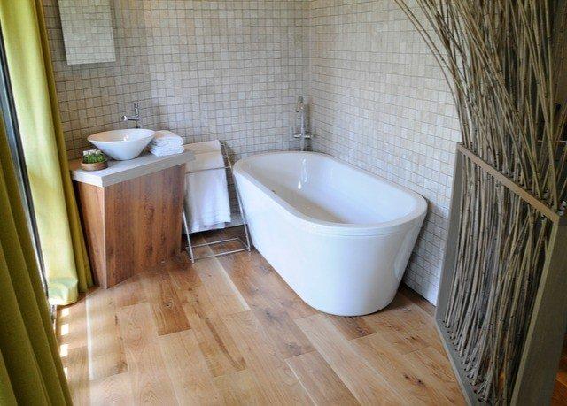 bathroom property flooring hardwood bathtub bidet plumbing fixture tub