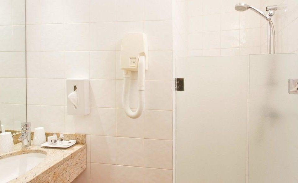 bathroom toilet plumbing fixture sink flooring tile bidet shower bathtub tiled tan