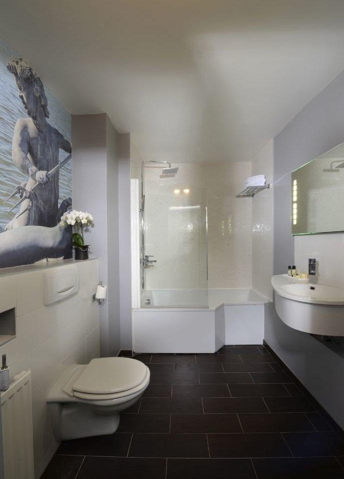 bathroom property toilet home sink flooring plumbing fixture bathtub bidet