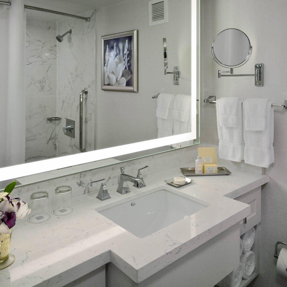 bathroom sink mirror property bathtub plumbing fixture toilet home white bidet flooring water basin