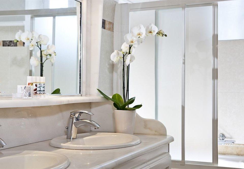 bathroom sink toilet plumbing fixture bathtub flooring bidet water basin