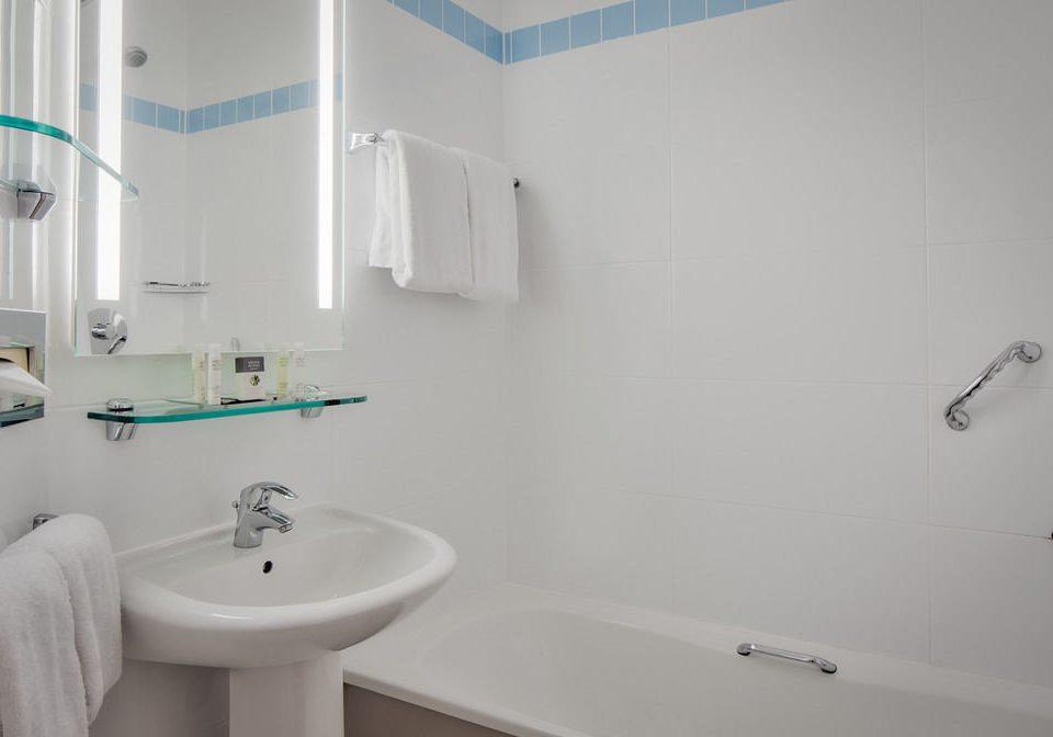 bathroom toilet sink property white bidet plumbing fixture bathtub flooring vessel water basin tile