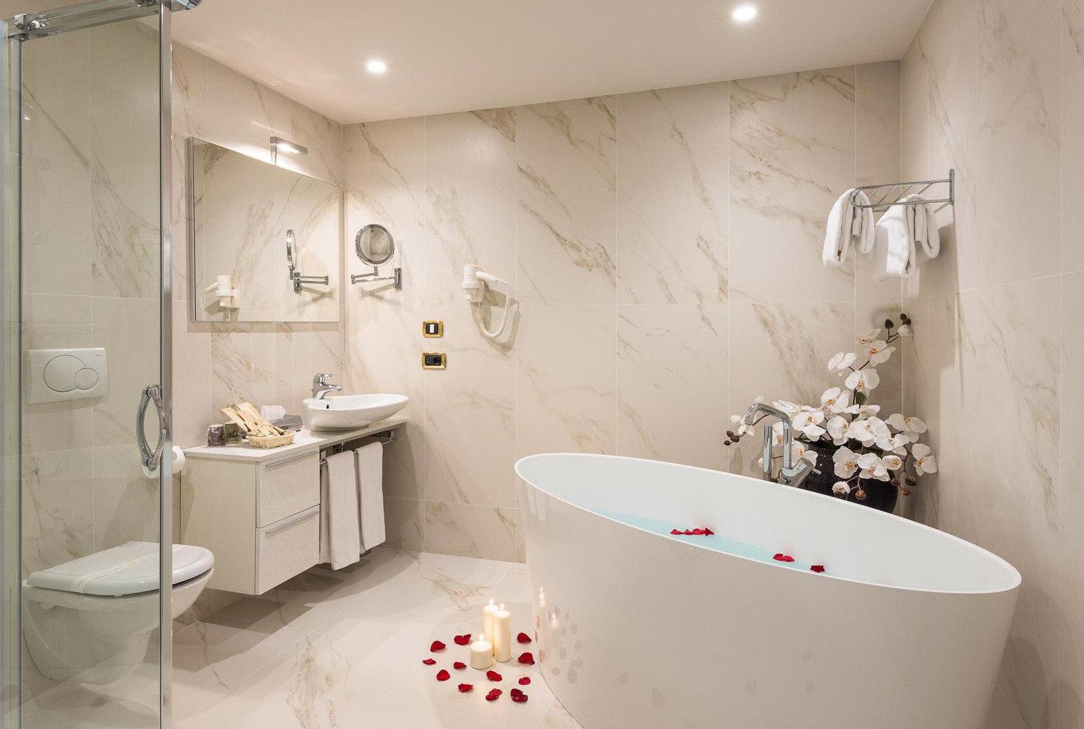 bathroom sink bathtub plumbing fixture bidet toilet flooring tiled