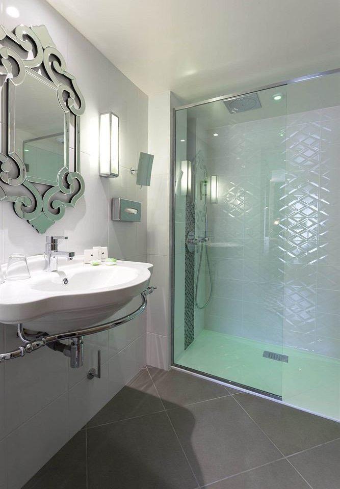 bathroom sink property green plumbing fixture bathtub shower vessel bidet flooring public toilet toilet tile tiled