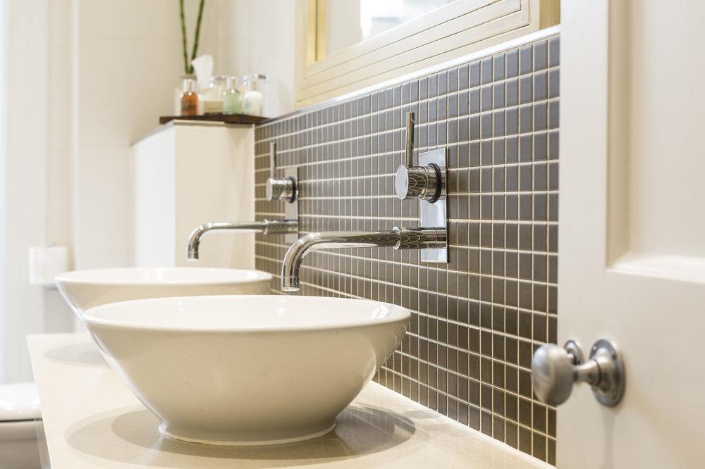 bathroom plumbing fixture bidet bathtub flooring tile sink toilet tiled