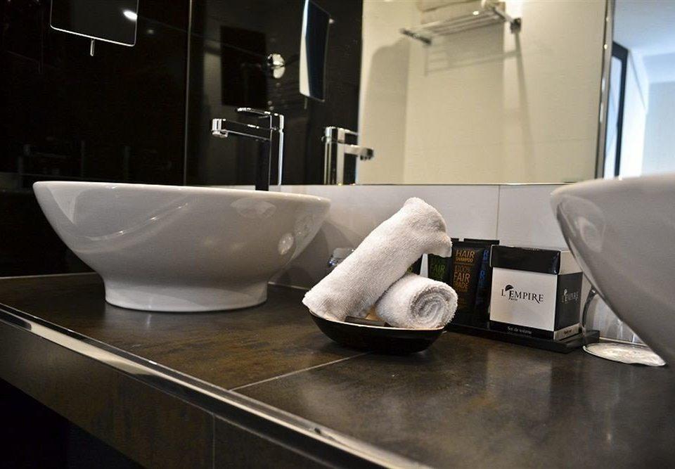 bathroom plumbing fixture bidet bathtub flooring sink toilet tile