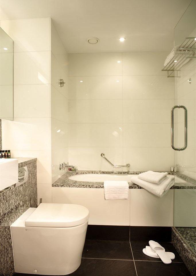 bathroom toilet bathtub plumbing fixture sink lighting bidet flooring