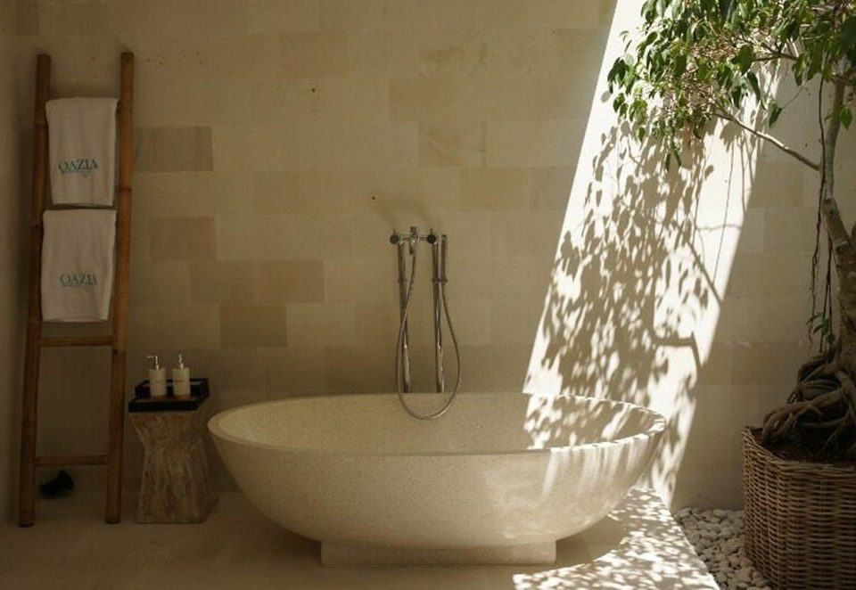 bathroom property plumbing fixture bathtub bidet flooring plant