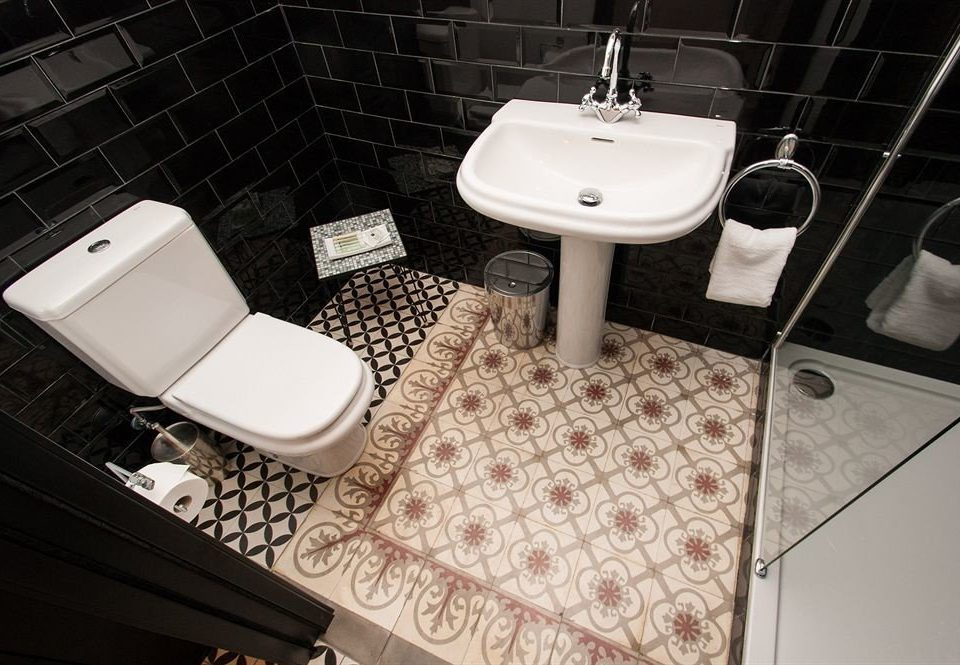 bathroom plumbing fixture bidet flooring sink tile bathtub toilet tiled
