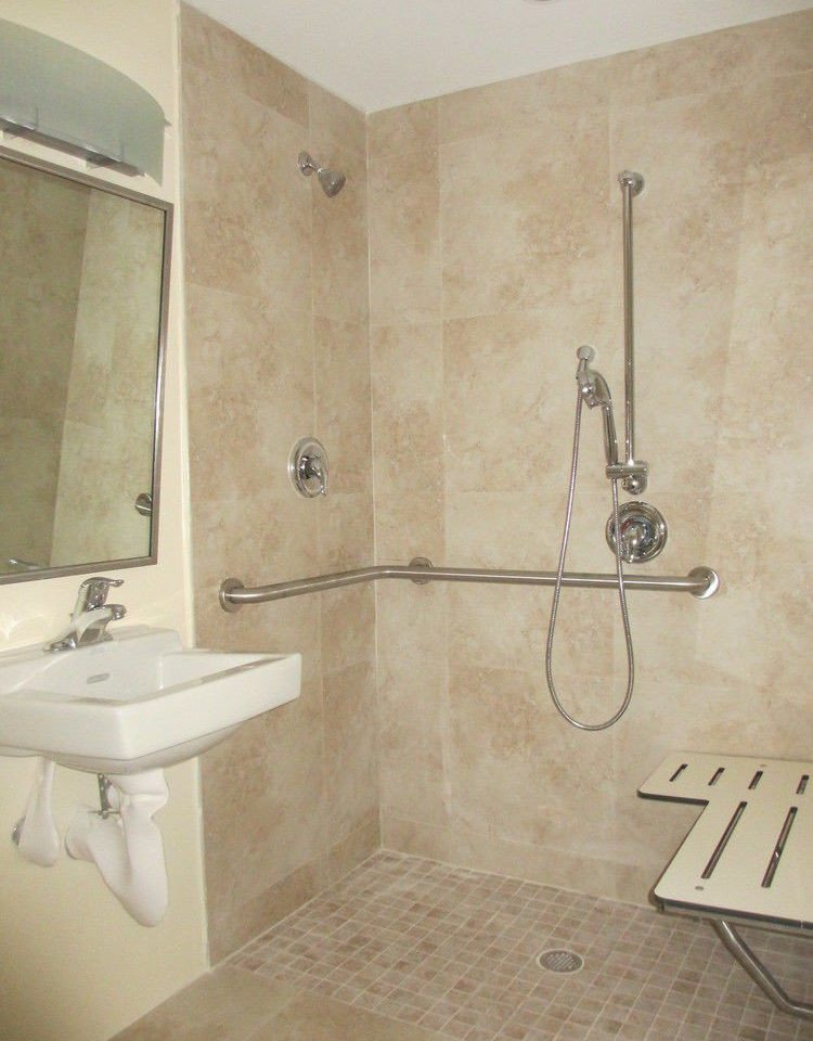 bathroom property scene plumbing fixture flooring tile sink bathtub bidet tiled