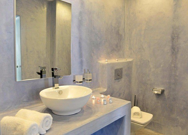 bathroom sink property toilet plumbing fixture bathtub bidet flooring tan