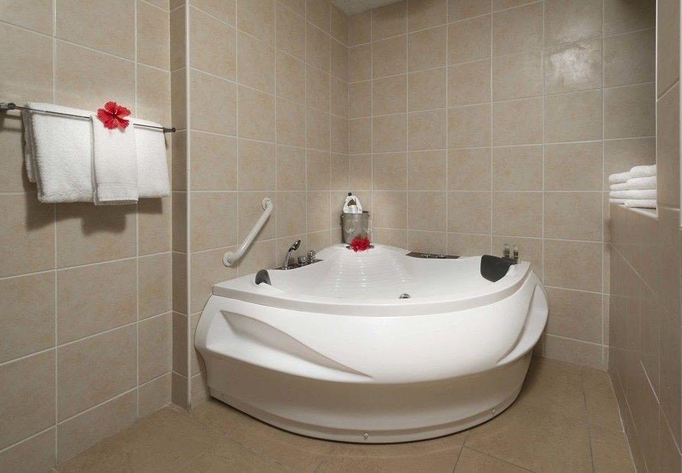 bathroom property bathtub plumbing fixture bidet toilet vessel flooring jacuzzi public toilet tile tiled