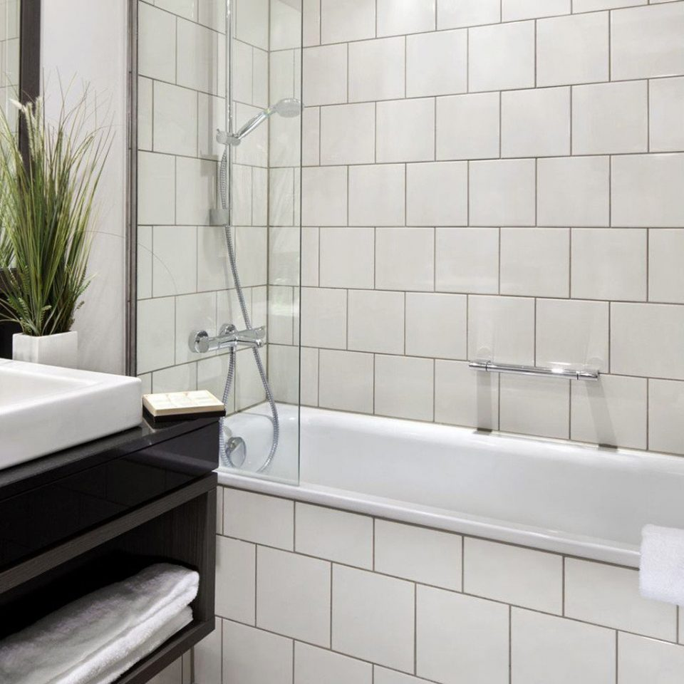 bathroom tile sink flooring plumbing fixture bidet bathtub white tiled public