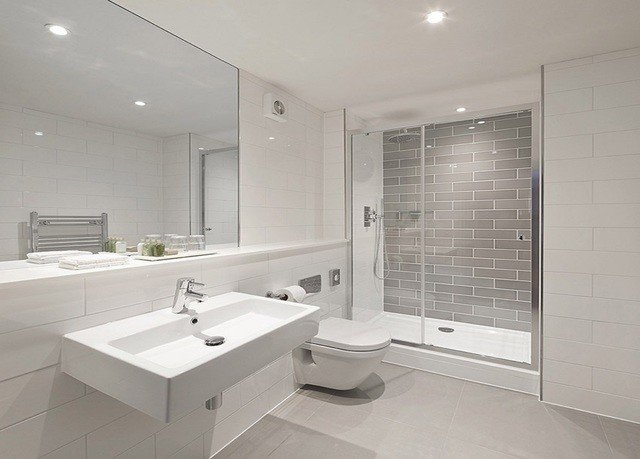 bathroom property sink home flooring toilet bathtub bidet plumbing fixture tub tile