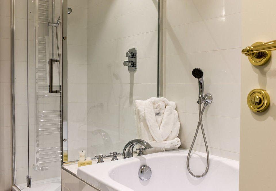 bathroom sink scene plumbing fixture white bidet bathtub flooring toilet