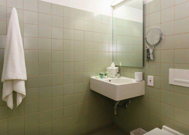 bathroom sink property toilet plumbing fixture bidet tile flooring public toilet bathtub tiled