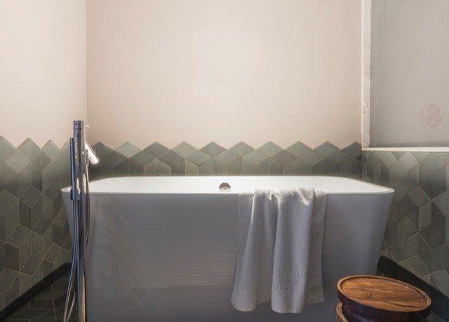 property bathtub bathroom plumbing fixture bidet swimming pool jacuzzi sink rack