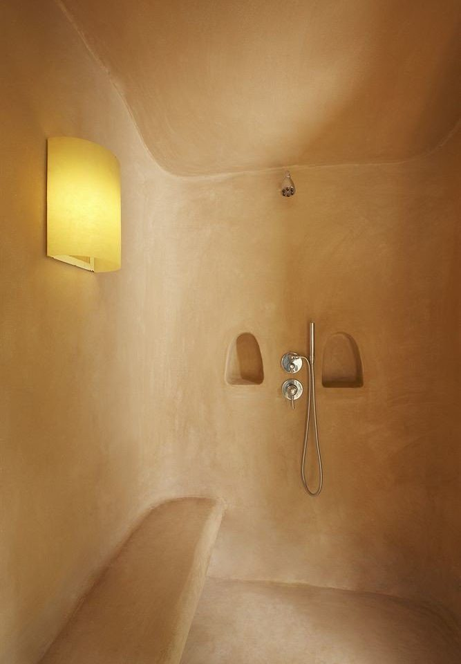 bathroom plumbing fixture lighting bathtub bidet plaster toilet tan