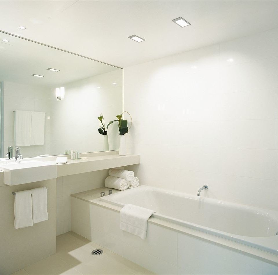 bathroom mirror property vessel sink white toilet bathtub plumbing fixture bidet long tile