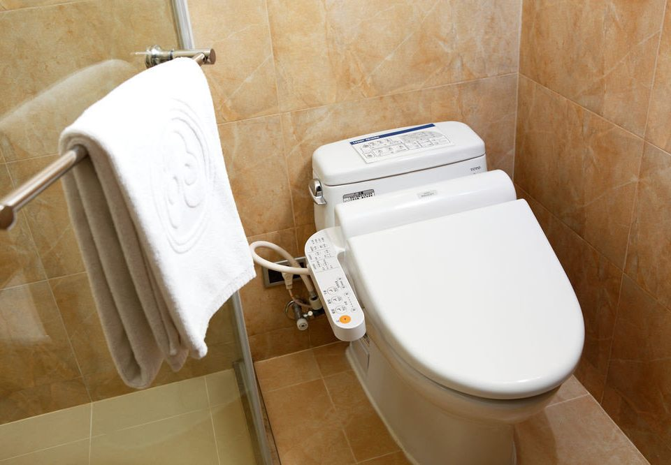 bathroom toilet man made object plumbing fixture bidet bathtub urinal white sink toilet seat public toilet tile tan tiled