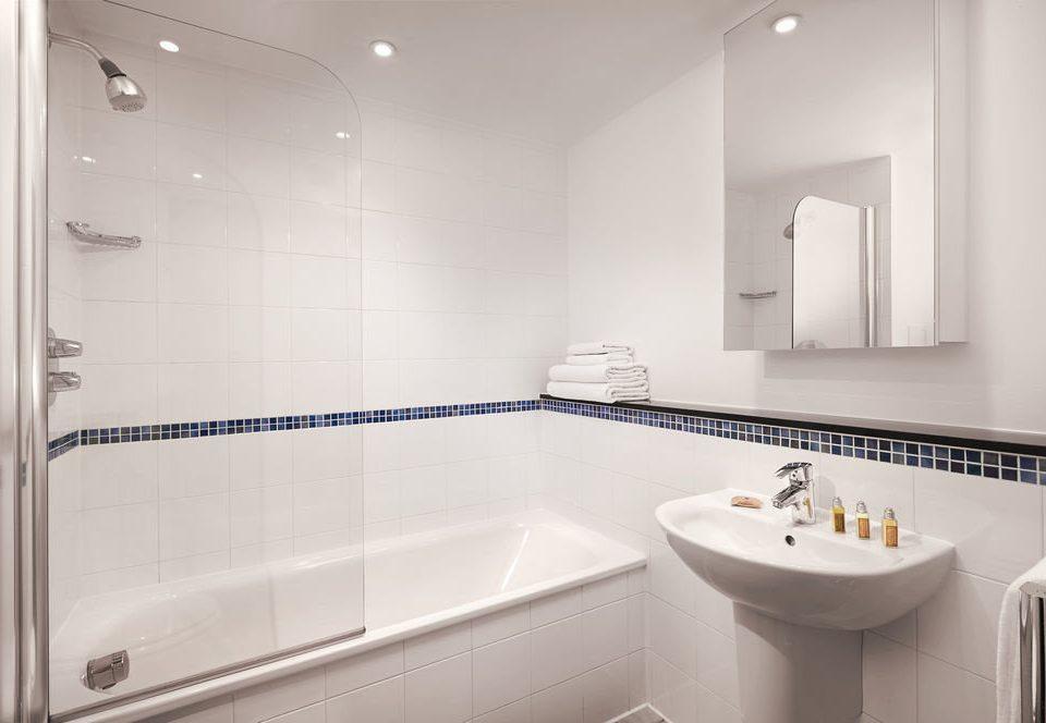 bathroom sink property mirror scene toilet white vessel bathtub plumbing fixture bidet tile
